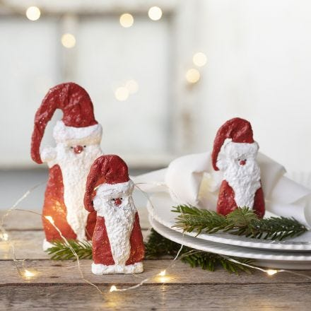 A wooden Father Christmas covered with gauze bandage