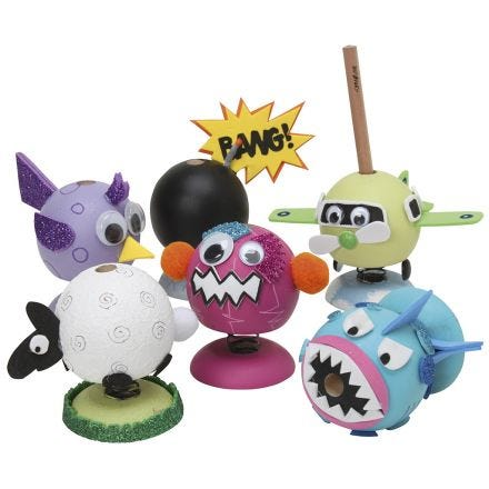 Wooden bouncy figures decorated with paint and foam rubber