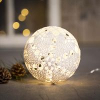An illuminated Christmas bauble from cotton yarn