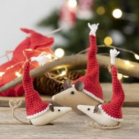 Crocheted mini elves' hats for wooden mice