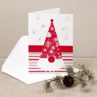 A Christmas card with a nosy elf made from design paper