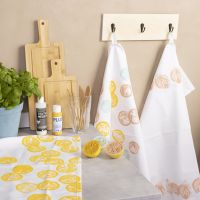 Stamped designs on fabric using fruit and vegetables